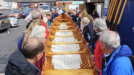 Twenty-three members of Sidmouth Gig Club turn the gig boat in under a minute. Picture SIDMOUTH GIG