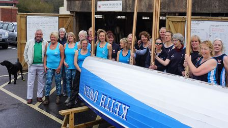 Sidmouth Gig Club chair Gina Rodgers with Rotary Club present John Kinch together with rowers and th