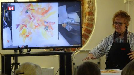Dee Cowell and her painting. Picture: Sidmouth Society of Artists