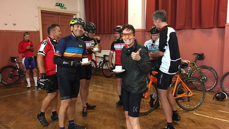 The happy cyclists relaxing after a ride with a cup of tea. Picture: The Ottery St Mary King & Queen