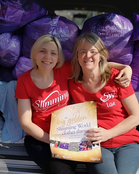Harriet Steptoe and Lisa Craig present the bags to the Cancer Research UK shop in Sidmouth. Picture: