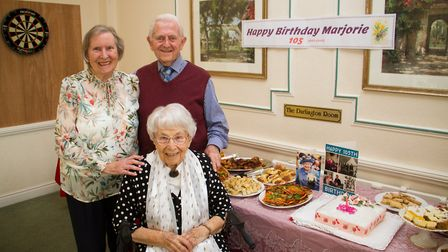 Marjorie Hodnett celebrating her 105th birthday with Eric and Babara Lang who are celebrating their