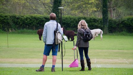 Alick Russell and Pippa Westall keep an eye on proceedings at the Sidbury cricket Alpaca fundraising