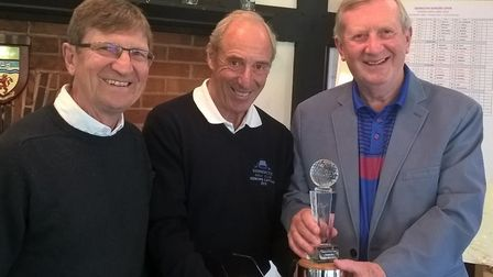 Sidmouth Seniors Open winners Len Wright (left) and Richard Seaver receiving the trophy from Sidmout