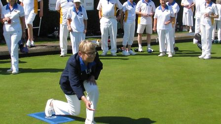 Ottery St Mary Bowls Club presidentMaggie Beighton send the tradional first wood down the rink to la