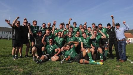 Sidmouth RFC players and officals celebrate after the 1st XVs win in the final of the Devon Intermed