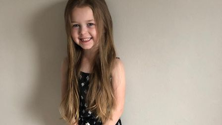 Megan Waterfield, five, will have 12 inches of her Rapunzel hair cut to raise money for the Little P