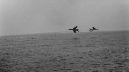 Sidmouth record congaline - 1977. The Red Arrows fly in at 6pm to give their aerobatic display. Pict