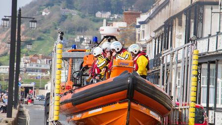 Sidmouth Lifeboat crew reacting to a shout on Good Friday. Ref shs 17 19TI 2824. Picture: Terry Ife