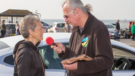 Lynette Talbot being intervewed on Sid Radio at the Sidmouth Hot Cross Bun give-a-way. Ref shs 17 19