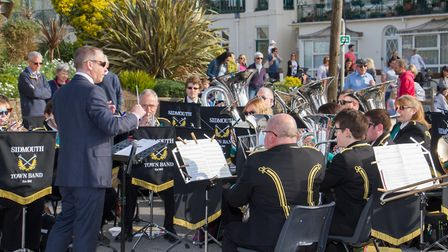Sidmouth Town Band at the Sidmouth Hot Cross Bun give-a-way. Ref shs 17 19TI 2673. Picture: Terry If