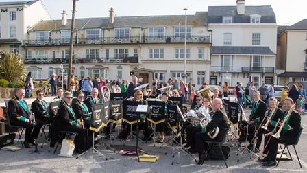 Sidmouth Town Band at the Sidmouth Hot Cross Bun give-a-way. Ref shs 17 19TI 2672. Picture: Terry If