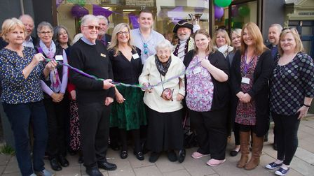 105-year-old Marjorie Hodnett cuts the ribbon at the opening of Age Concern Sidmouth. Ref shs 16 19T