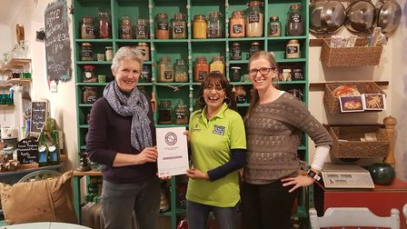 Samosa Lady being presented with her award from Plastic Free Ottery's Katy Lancaster and Sally Price