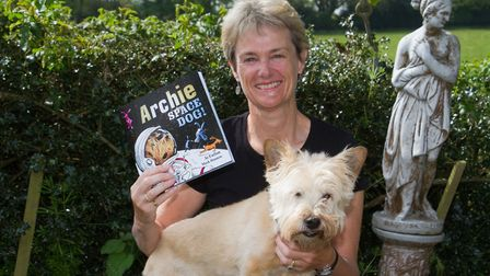 Jo Earlam with her new book based on her dog Archie. Ref shs 18 19TI 3476. Picture: Terry Ife