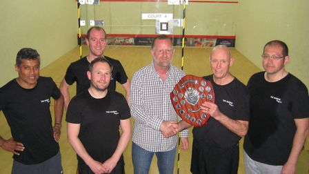 Sidmouth's winning racketball team receiving the plate trophy from Devon League secretary Alan Ford.