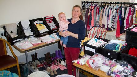 Zoe Legg with her daughter Mallorie and some of the donations for the baby bank. Ref sho 18 19TI 353