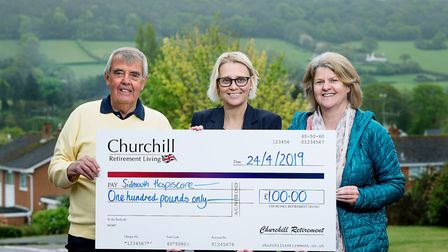 Churchill Retirement Living present a cheque to Sidmouth Hospiscare after the winner of the competit