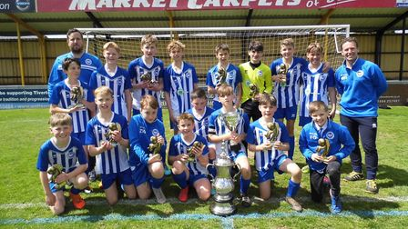 Ottery St Mary Under-13s after their Exeter and District Youth Cup final success at the home of Tive