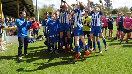 Ottery St Mary Under-13s celebrate after their Exeter and District Youth Cup final success at the ho