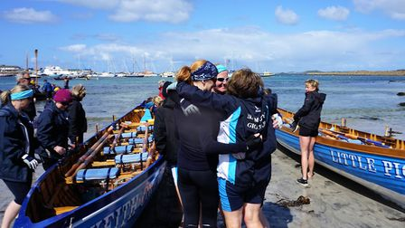 Sidmouth Gig Club members hug post race at the World Gig championships. Picture SGC