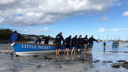 Sidmouth Gig Club members take a gig out to the sea ahead of racing at the 2019 World Gig Championsh