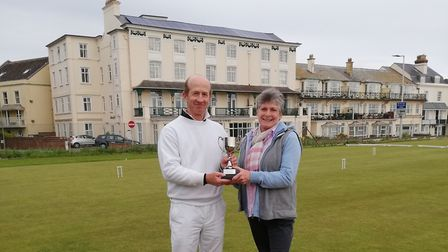 Jonathan Powe is presented with the Haste Cup by Amanda Haste, a long standing member of Sidmouth Cr
