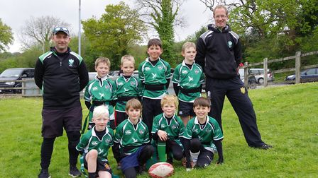 Sidmouth RFC Under-8s with their coaches. Picture SIDMOUTH RFC