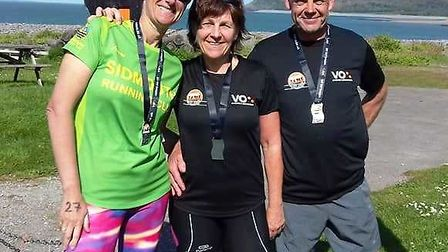 (Left to right) Sidmouth Running Club trio Jo Earlam, Sarah Watkins and Paul Williamson after comple