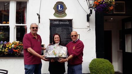 Anchor Inn 1st prize winner Louise Brooks with Lions Mike and Jeff.