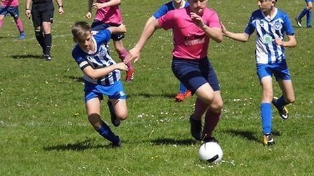 Ottery St Mary Under-13 players Finn Lashbrook (left) and Tom Bennett in action during the 4-2 win a