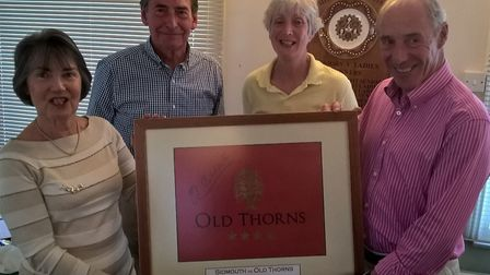 Sidmouth ladies captain Gill Paddon (left) and Seniors captain Chris Grubb (right) receive a framed