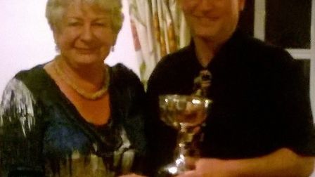 Andrew Lowe, winner of the Men's Matchplay Singles, receiving his trophy from Sidmouth ladies captai