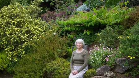Barbara Mence in her garden in Woolbrook Park. Ref shs 23 19TI 5733. Picture: Terry Ife