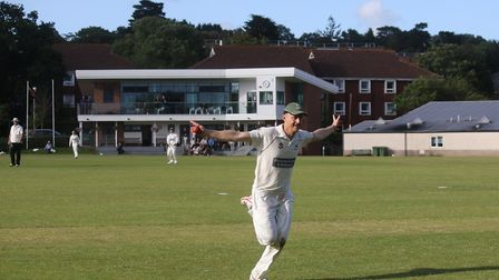 Sidmouth's Will Murray celebrates after taking a superb catch in the win at Exeter. Picture GERRY HU