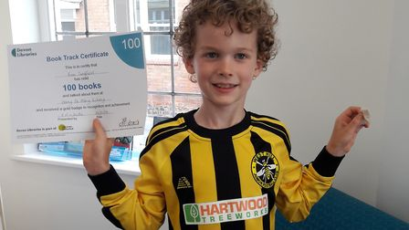 Finn Signfield, seven, has completed the book challenge at Ottery Library. Picture: Xanthe White