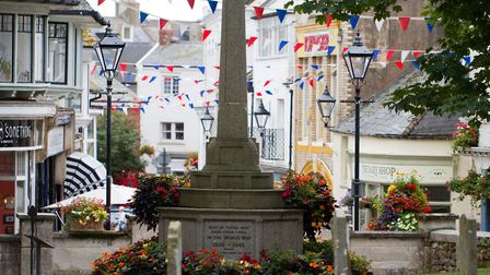 Flowers at Sidmouth War Memorial. Ref shs 33 18TI 0222. Picture: Terry Ife