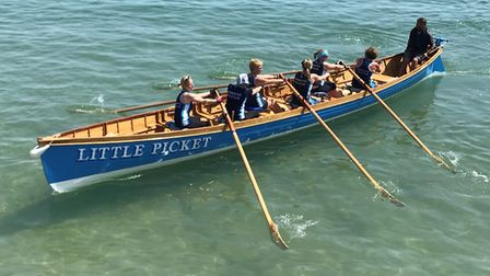 Sidmouth Gig Club ladies A crew backing out for their race at the Swanage Regatta. Picture: SIDMOUTH
