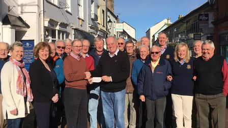 John Kinch, president of the Rotary Club of Sidmouth, presents John Summerside of the Memory Cafe wi
