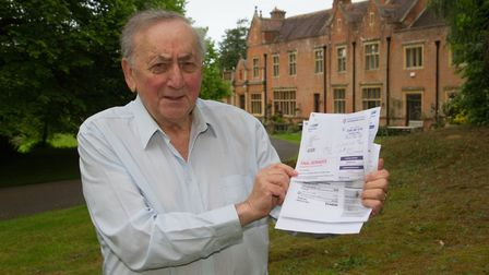 Louis Herberg with his water bill. Ref shs 23 19TI 5674. Picture: Terry Ife