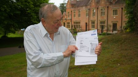 Louis Herberg with his water bill. Ref shs 23 19TI 5662. Picture: Terry Ife