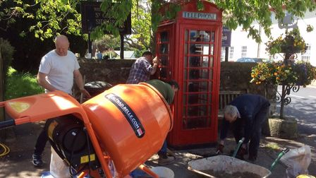 Hard work went in to move and redecorate the iconic telephone box. Picture: Andy Webb