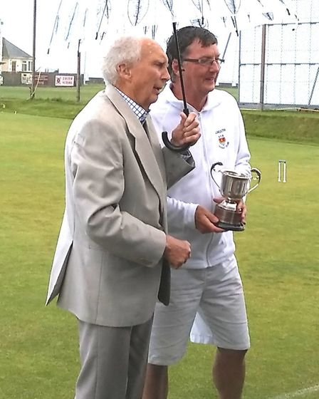 Richard Wood receives the A Block Cup from club president David Temple. Picture SIDMOUTH CROQUET CLU
