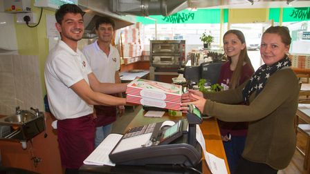 Zenel and Erando Sinanaj of PizzAmore in Ottery St Mary with some customers. Ref sho 24 19TI 6642. P