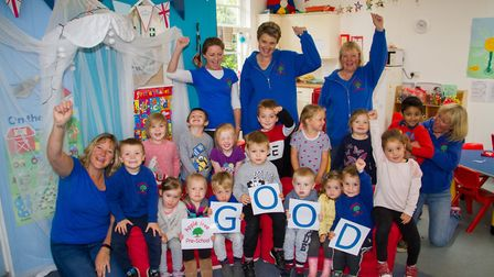 Tracy Johnson and her staff celebrate their good OFSTED report with the children at Apple Tree Pre-S