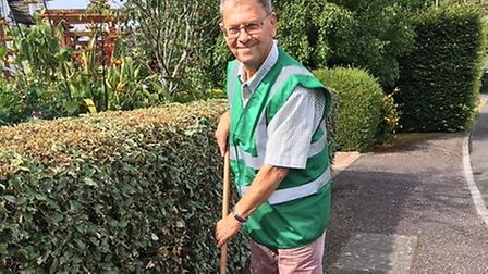 Peter Endersby of Sidmouth in Bloom will be among those helping clean up the town this weekend. Pict