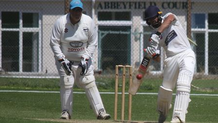 North Devon wicket keeper Richard Screech with Alex Barrow the Sidmouth batsman. Picture GERRY HUNT