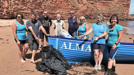 Sidmouth Gig Club crew at Sandy Cove all set for the beach clean-up. Picture SIDMOUTH GIG CLUB