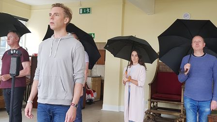 Chris Casey, centre, and other cast members rehearsing The King's Speech. Picture: Jonny Clines