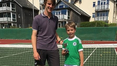 Coach Gregg Shipp with Mini Red title winner Max Imbeck. Picture: SIDMOUTH TENNIS CLUB